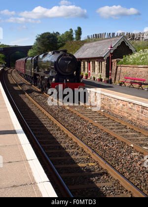 The Fellsman Hauled by 46115 Scots Guardsman passing Dent Station Dentdale Yorkshire Dales Cumbria England - Stock Photo