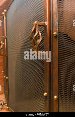 the copper chimney lattice with the beautiful handle serves as protection against fire - Stock Photo