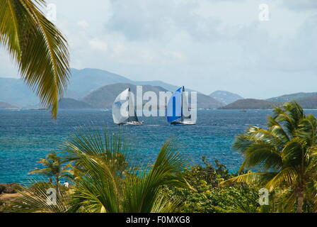 Two sailboats on the Caribbean sea off the island of St. Thomas, US Virgin Islands.  St. John and islands in the - Stock Photo