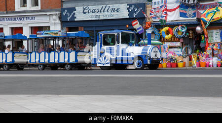 The 'land train' tourist ride in Exmouth, stopping outside a beach shop. - Stock Photo