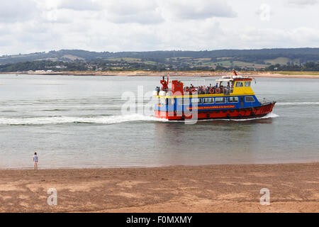 'Pride of Exmouth' ferry being watched from beach by a small girl. - Stock Photo