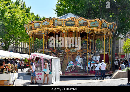 Avignon festival French old fashioned style carousel with stairs seen during the annual July arts festival in the - Stock Photo