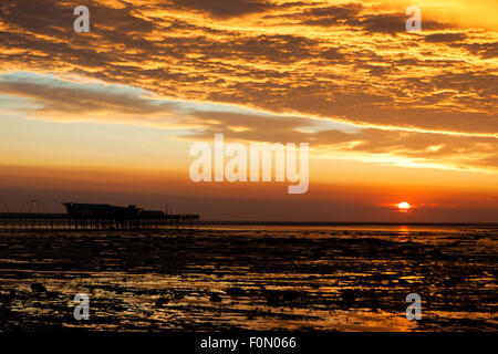 Southport, Merseyside, UK. 18th Aug, 2015. A beautiful sunset hovers over Southport Pier in Merseyside.  Not only - Stock Photo