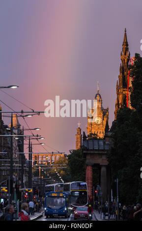 Edinburgh, UK. 18th Aug, 2015. A rainbow appeared at the east end of Edinburgh's famous Princes Street lighting - Stock Photo