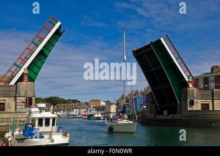 Horizontal view of Town Bridge open in Weymouth, Dorset. - Stock Photo