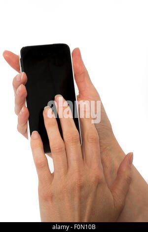 Isolated female hands holding smart phone similar to iphone with isolated black screen - Stock Photo