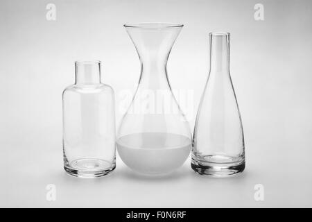Assorted Glass Bottles of Various Shapes and Sizes on Seamless Background - Stock Photo