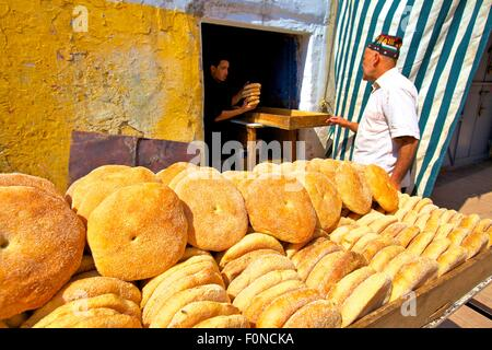 Baker with Freshly Baked Bread, Rabat, Morocco, North Africa - Stock Photo