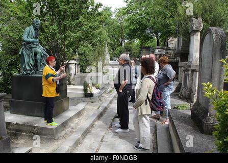 Tour guide Père Lachaise Cemetery large cemetery in Paris France.near the tomb of Vivant baron Denon. - Stock Photo