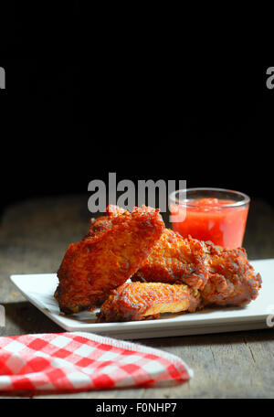 Fried Chicken Wings on wood  background - Stock Photo