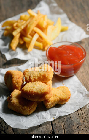 Chicken Nuggets with French Fries - Stock Photo