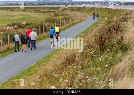 Cyclists and walkers on the river Exe trail and Coast path, west side of the river. - Stock Photo