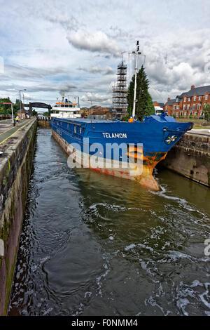 Coastal freighter 'Telamon' passing through Latchford Locks on the Manchester Ship Canal at Warrington, England. - Stock Photo