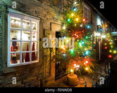 Christmas illuminations in the Peak District village of Castleton Derbyshire England - Stock Photo