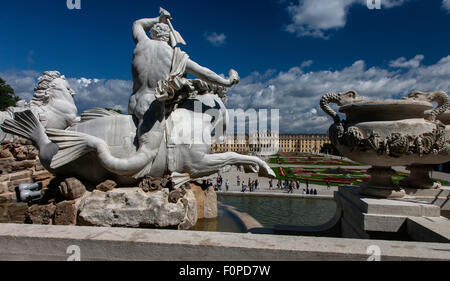Schoenbrunn Palace and Gardens with Neptun Fountain in foreground, Vienna, Austria - Stock Photo