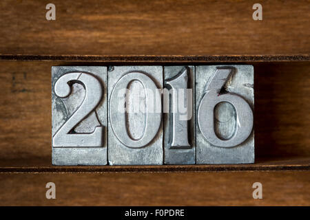 2016 year made from metallic letterpress type on wooden tray - Stock Photo