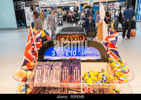 The Queen greets tourists at tourist shop outlet 'Glorious Britain' gift shop. Departures Terminal, Stansted Airport,London,U.K. - Stock Photo