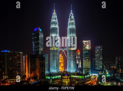 Petronas Towers, Kuala Lumpur, Malaysia at night - Stock Photo