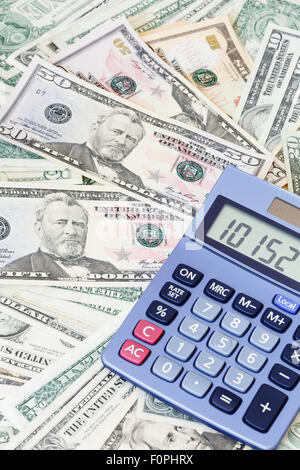 Blue calculator and American dollar currency background - Stock Photo