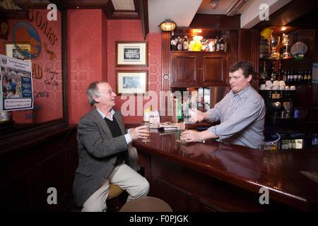 Publican and local man inside the Boar's Head Pub, Capel Street, Dublin, Republic of Ireland - Stock Photo