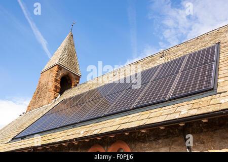 Solar panels on roof of St Paul's Church, Pooley Bridge, Ullswater, Lake District, Cumbria, England - Stock Photo