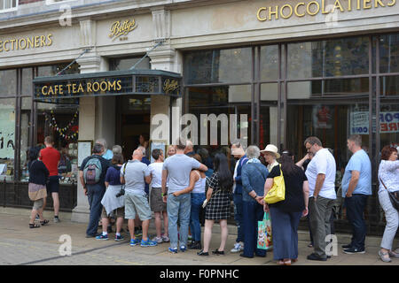 Queue outside Betty's Cafe and Tea Rooms, York, Yorkshire, England. - Stock Photo