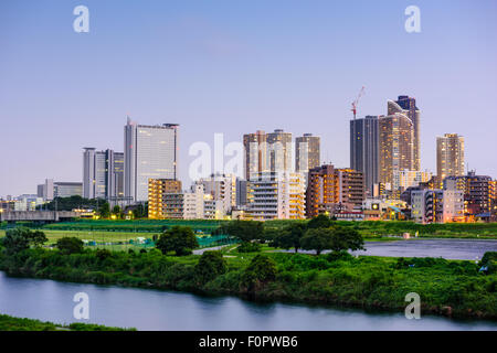 Kawasaki, Japan skyline at the Tamagawa River. - Stock Photo