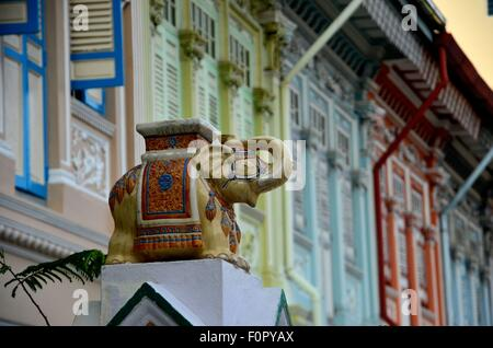Traditional Asian decorated elephant guards house gate Singapore - Stock Photo