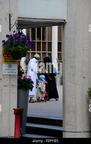 British Muslim family with child at Regents Park mosque London England - Stock Photo