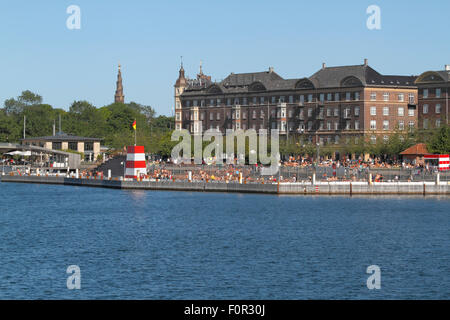 The Copenhagen Harbour Bath at Islands Brygge in the inner harbour of Copenhagen on a warm and  sunny summer day - Stock Photo