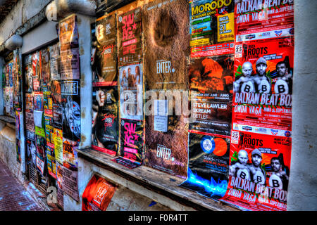 posters stuck on wall advertising bill posting adverts Ibiza clubs concerts events advertised bill posters adverts - Stock Photo