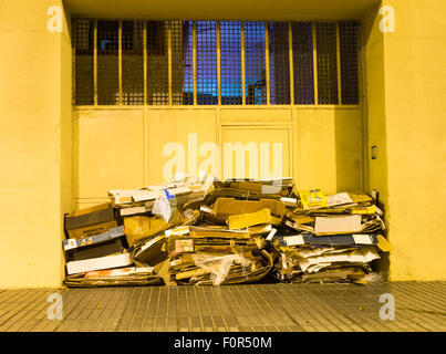 Cardboard waste ready for collection outside business premises in Spain - Stock Photo