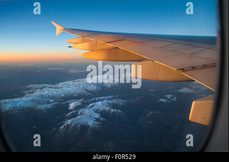 Wing of an Airbus A380-800 over snowy mountains, Balkan Mountains - Stock Photo