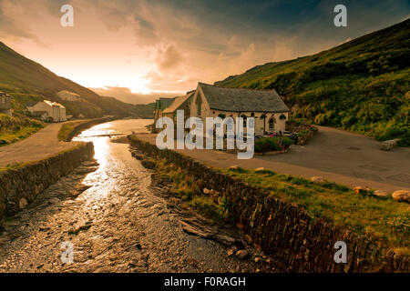The Harbour Light tea room at sunset in Boscastle, north Cornwall, England, UK - Stock Photo