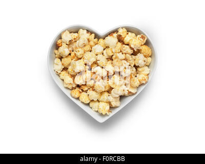 Shot of cinema style popcorn in a heart shaped bowl isolated on a white background with a clipping path and copy space for the d