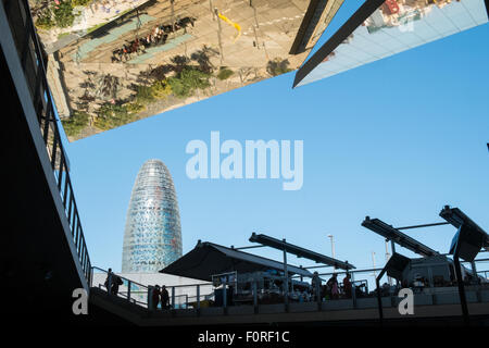 AGBAR tower and mirrored ceiling of Els Encants open-air flea market, vendors and second-hand goods, Barcelona, - Stock Photo