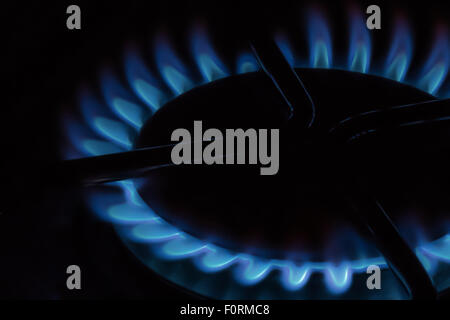 Cooking plate: cooktop - Gas stovetop burning in dark background - Stock Photo