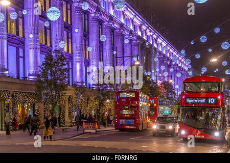 London Buses outside Selfridges on Oxford St filled with Christmas shoppers at Christmas Time with the Oxford St - Stock Photo