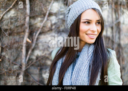 Portrait of a smiling  young woman in winter - Stock Photo