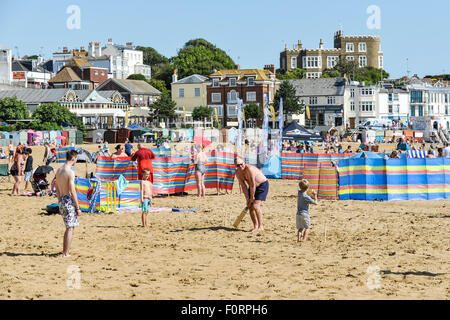 Holidaymakers on the beach at Viking Bay in Broadstairs, Kent. - Stock Photo