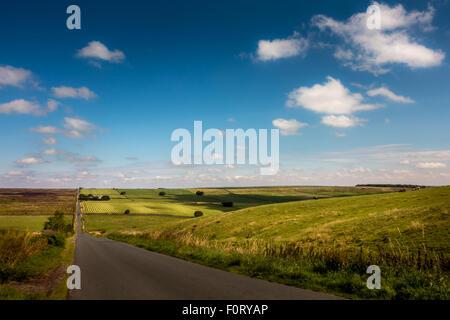 One of North Yorkshire's beautiful, quiet, straight roads, near Pateley Bridge, UK - Stock Photo