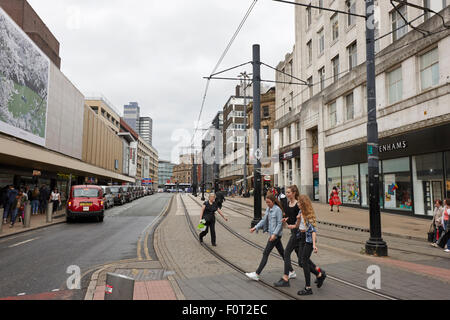 high street with tram lines Manchester England UK - Stock Photo