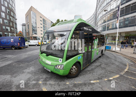 metro shuttle free electric bus service in Manchester city centre England UK - Stock Photo