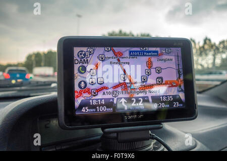 TomTom sat nav, TomTom satnav, satellite navigation showing live traffic information heavy congestion and a way - Stock Photo