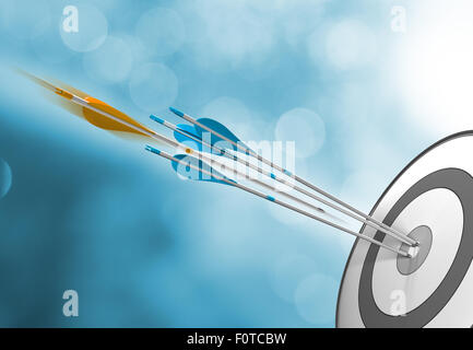 Three blue arrows hitting target center plus an orange one in motion about to hit the bullseye. Concept image for - Stock Photo