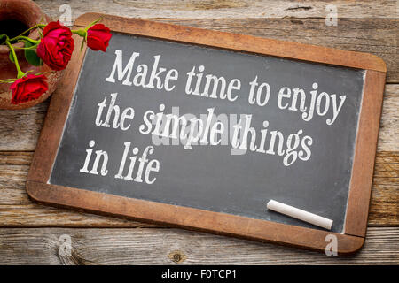 Make time to enjoy the simple things   inspirational advice - white chalk text on a vintage slate blackboard with - Stock Photo