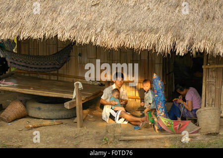 lao family at the borders of mekong river in lao asia - Stock Photo