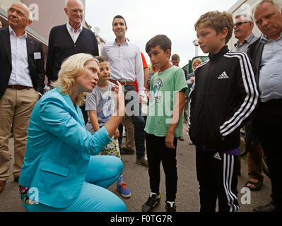 German Family Minister Manuela Schwesig talks to a young volunteer named Felix in a refugee accommodation, Germany, - Stock Photo