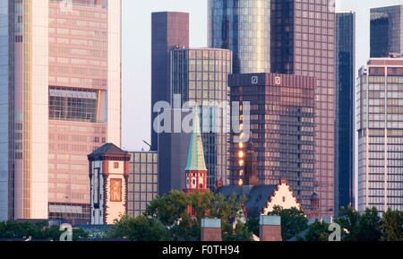 Langer Franz and Old Nikolai Church in front of skyscrapers in the financial district in the morning light, Frankfurt - Stock Photo