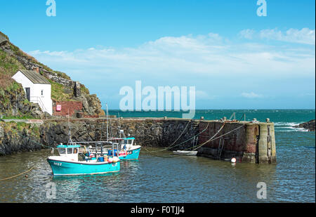 Porthgain Harbour with moored boats Pembrokeshire Coast National Park West Wales UK - Stock Photo